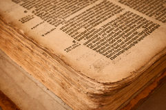 Worn pages in old book. Close up of the corner of an old bible Royalty Free Stock Photos