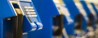 Close up old blue public telephone Use coins to pay that is outdated in past Now is not popular,banner horizontal for web stock photo