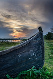 Close-up of old boat stranded on the shore. Vertical view of an Royalty Free Stock Images