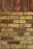 Old brick wall. Close-up of and old brick wall. There are two main brick colors : red and yellow. The picture was taken indoors Stock Photo