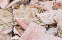 Detail view old damaged tiles at construction site stock images