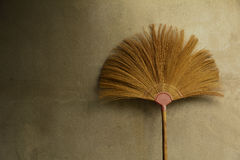 Close up old broom grass on the wall sepia. Royalty Free Stock Photography