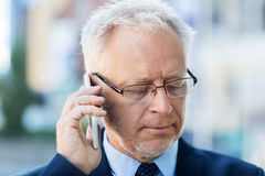 Close up of old businessman calling on smartphone Royalty Free Stock Image