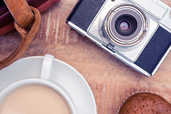 Close-up of old camera with diaries and coffee. On table Royalty Free Stock Photography