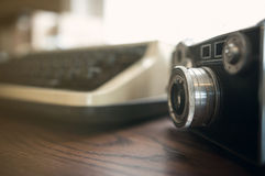 Close up, Old camera with old typewriter. Stock Images