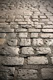 Close up of old cobble stone road surface background texture Stock Images