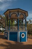 Close-up of old colorful gazebo in the middle of verdant garden full of trees, in a sunny day at São Manuel. stock photography