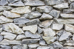 close up of a old and cracked stoned wall Stock Image