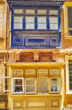 Old Mlatese balconies, Valletta, Malta. The close-up of old different colored dusty Maltese balconies, St Dominic street, Valletta, Malta Stock Images