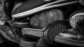 Close up of old dirty male shoes. Used shoes. Heap of old shoes. Many of dirty men shoe. Men shoes collection with not organized. stock photos