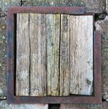 Old dirty wooden frame with metal edging. Stock Photos