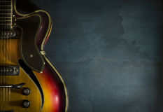 Close-up of old electric jazz guitar on a dark blue background Stock Photography