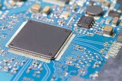 Old electronic circuit chip on pcb board Royalty Free Stock Image