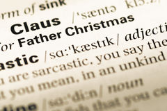 Close up of old English dictionary page with word father christmas Royalty Free Stock Image