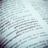 Close up of old English dictionary page with word Photographer. Royalty Free Stock Photos