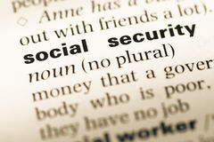 Close up of old English dictionary page with word social security Royalty Free Stock Images