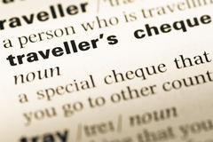Close up of old English dictionary page with word traveller's cheque stock photography