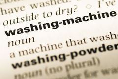 Close up of old English dictionary page with word washing machine stock images