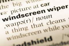 Close up of old English dictionary page with word windscreen wiper stock photography
