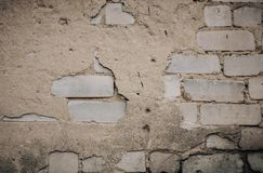 Close Up of an Old Exterior Brick Wall with Stained and Peeling White Paint stock photo