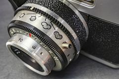 Old-fashioned camera and lens. Close up old-fashioned camera and lens stock images