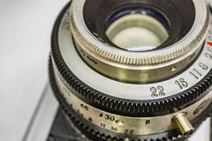 Old-fashioned camera and lens. Close up old-fashioned camera and lens royalty free stock image