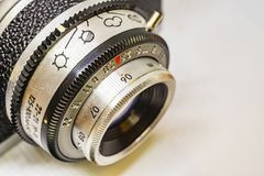 Old-fashioned camera and lens. Close up old-fashioned camera and lens stock photography