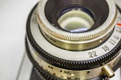 Old-fashioned camera and lens. Close up old-fashioned camera and lens royalty free stock photo