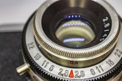 Old-fashioned camera and lens. Close up old-fashioned camera and lens royalty free stock photography