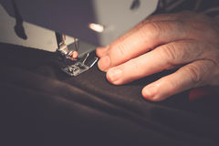 Close-up old female hands sewing fabric Stock Photos