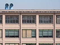 Close up of old Fiat Factory building in Turin Italy built in the 1920s, recently renovated by Renzo Piano. Turin, Italy. Close up of old Fiat Factory building stock photo