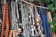 Close up old fishing tackle - rope, float Stock Images