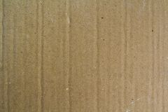 Close up old grainy decorative light brown vintage rough sheet of carton cardboard paper texture or background. Close up old grainy decorative light brown royalty free stock photography