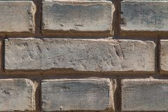 Old Brick Wall Texture. Close up of an old gray brick wall revealing it`s scratched surface Royalty Free Stock Photo