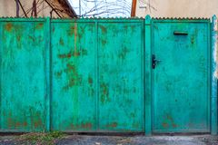 Old green fence and door. Royalty Free Stock Photography