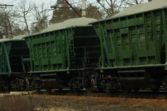 Close up of old green rail freight train in motion transporting cargo. Close up of old green rail freight train in motion transporting bulk cargo Royalty Free Stock Photo