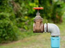 Close up old grunge brass faucet water in nature park background Stock Images