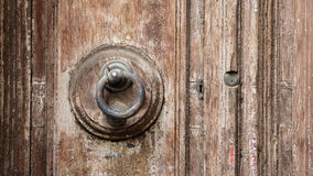 Close-up of an old handle and two types of locks on a brown wood Stock Images