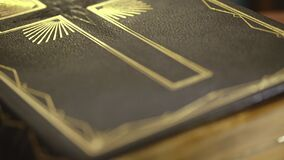 The holy bible book. Close up of old Holy bible book, camera track stock footage