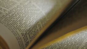 The holy bible book. Close up of old Holy bible book, camera track stock video