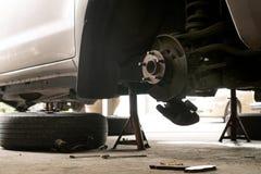Close up of old hub wheel car. Rust on hub wheel. Rear wheel. Close up of old hub wheel car in garage. Rust on hub wheel. Rear wheel Royalty Free Stock Images