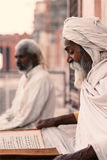Close up of a old indian sadhu reading scriptures. Stock Image