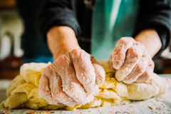 Close up of old  italian lady's hands making home made italian pasta Royalty Free Stock Photo