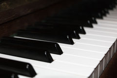 Close-up on an old ivory piano keyboard Stock Images