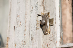 Close up of an old latch on the door lock. Closeup and vintage door locked with latch stock image
