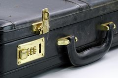 Close up of an old leather briefcase with golden combination lock stock photo