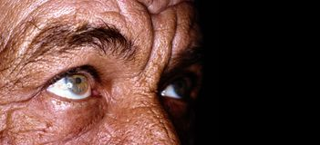 Close up of old man eyes. Sun burned and wrinkled skin Stock Photo