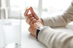Close up of old man hands with pill. Age, medicine, healthcare and people concept - close up of senior man hands with pill Royalty Free Stock Images