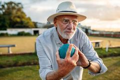 Elderly man playing a game of boules stock image