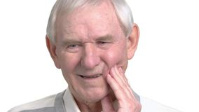 Close up old man having strong toothache. stock video
